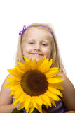 Child (girl) holding a sunflower in hands Royalty Free Stock Images
