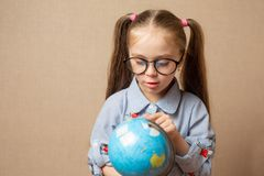 Cute little girl hugging globe. save the earth concept. stock images