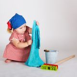 Child girl housewife cleaner Stock Images