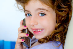Child girl indented talking mobile telephone Stock Images