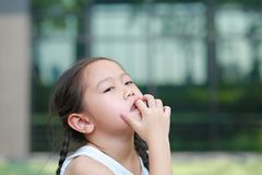 Child girl intend sucking her fingers royalty free stock photo