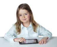 Child girl ipad laptop isolated.Kid use electronic device. Royalty Free Stock Photo