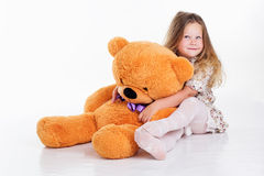 Free Child Girl Is Hugging Her Teddy Bear Royalty Free Stock Photos - 60732618