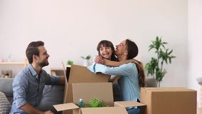 Child girl jump out of box playing on moving day