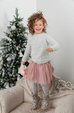 Child girl jump with sheep toy at Christmas Royalty Free Stock Image