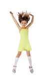 The child, a girl jumping and dancing. Studio photography of the child Royalty Free Stock Images
