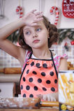 Child girl in the kitchen Stock Images