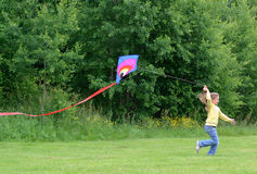 Child girl with kite stock photo