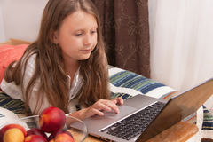 Child (girl)l with laptop Royalty Free Stock Photography