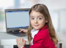 Child girl laptop computer st table background. Stock Image