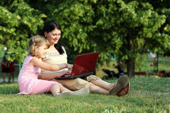 Child and girl with laptop Stock Photography