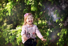 Child girl laughing. Blonde child girl laughing, spring Royalty Free Stock Image