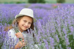 Child girl is in the lavender field, beautiful portrait, face closeup, summer landscape Stock Images