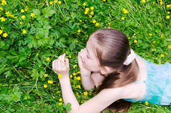 The child the girl lies on a glade Royalty Free Stock Image