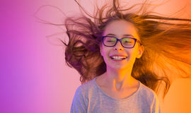 Child girl with long hair flying - colorful background Royalty Free Stock Images