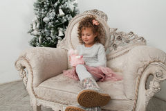 Child girl look at sheep toy at Christmas Stock Image
