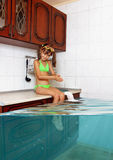 Child girl make mess, flooded kitchen imitating swimming pool, f Royalty Free Stock Photos