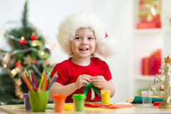Child girl making by hands christmas decorations Royalty Free Stock Photos