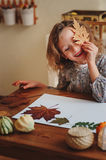 Child girl making herbarium at home, autumn seasonal crafts Royalty Free Stock Photo