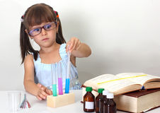 Child girl making science test Royalty Free Stock Photography