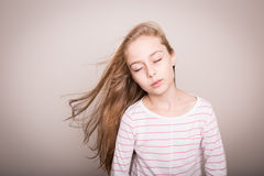 Child girl model with natural beautiful long straight hair. Stock Photos