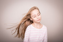 Child girl model with natural beautiful long straight hair. Royalty Free Stock Photos