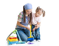 Child girl and mom cleaning room. Child girl and mother cleaning room isolated Stock Images