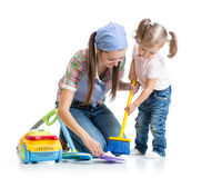 Child girl and mother sweep floor Royalty Free Stock Photo