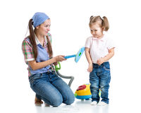 Child girl and mother with vacuum cleaner. Isolated Stock Photography