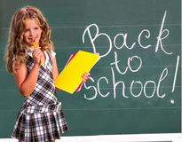 Child girl  near  blackboard Royalty Free Stock Photos