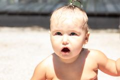 Child girl one year old surprised. portrait. close-up. royalty free stock photo
