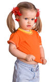 Child girl in orange t-shirt and jeans. Royalty Free Stock Image
