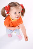 Child girl in orange t-shirt.White background. Royalty Free Stock Photos