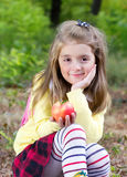 Child girl outdoors holding apple.Healthy lifestyle. Stock Photos