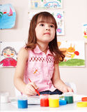 Child girl with paint and brush. Stock Image