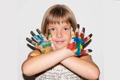 Child girl with painted fingers. Near face stock photos