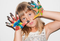 Child girl with painted fingers. Near face royalty free stock image
