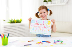 Child girl painted postcard for mom to mother`s day. Child girl painted drawing postcard for mom to mother`s day Royalty Free Stock Images