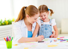 Child girl painted postcard for mom to mother`s day. Child girl painted drawing postcard for mom to mother`s day Royalty Free Stock Image