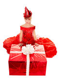 Child girl in party hat and red gift box. Birthday child girl in red party hat , dress with gift box. Isolated Royalty Free Stock Images