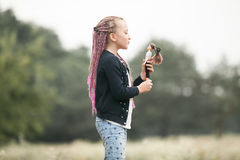 Child girl plays with her doll on walk. Royalty Free Stock Photos