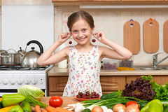 Child girl play and having fun with cherries, fruits and vegetab Stock Photos