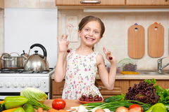 Child girl play and having fun with cherries, fruits and vegetab Royalty Free Stock Images