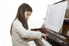 Child girl play piano stock image