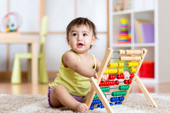 Child girl playing with abacus Stock Photography