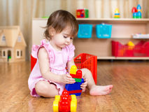 Child girl playing with block toys indoor Stock Photos