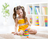 Child girl playing with colorful toys Stock Image