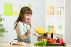 Child girl playing cook and preparing spaghetti Stock Photography
