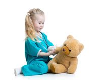 Child girl playing doctor Stock Images