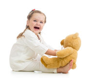Child girl playing doctor with toy Stock Images